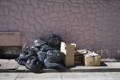 Boxes and bags of rubbish on a sidewalk Stock Photos