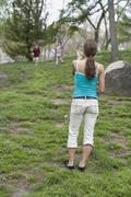 A mother beckoning her children in Central Park, New York City Stock Photos