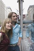 A young couple looking in a shop window, New York City Stock Photos