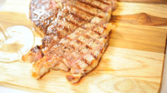 Close Up Healthy Lifestyle Cooked T-Bone Steak Red Wine Stock Footage