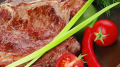 Savory : grilled spare rib on dark dish with pepper and tomato Stock Footage
