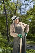 A senior man resting while doing gardening Stock Photos