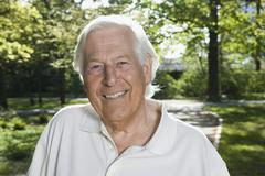 A portrait of a senior man, outdoors Stock Photos