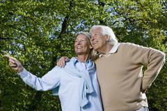 A senior couple looking away, outdoors Stock Photos