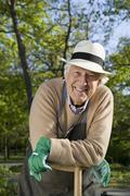 A senior man taking a break from gardening Stock Photos