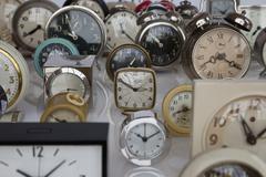 An array of clocks - stock photo
