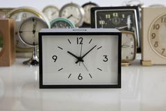 An array of alarm clocks - stock photo