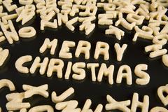 Letter cookies spelling out the phrase Merry Christmas Stock Photos