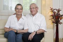 Formal portrait of a older couple - stock photo