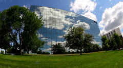 Cool wide angle shot of office building with reflective glass Stock Footage
