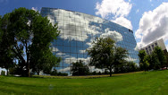 Stock Video Footage of Cool wide angle shot of office building with reflective glass