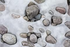 Patterns formed by ice over pebbles Stock Photos