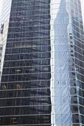 Skyscraper with distorted reflection of buildings, New York City, NY, USA Stock Photos