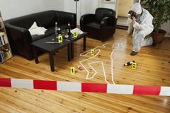 A person photographing a crime scene Stock Photos
