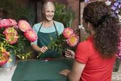 A woman buying flowers in a florists Stock Photos