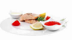 Salmon fillet pieces roasted with lemon and rosemary twig Stock Footage