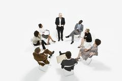 A group of business people in a meeting Stock Photos
