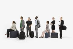 A group of business people standing in a line with luggage Stock Photos