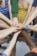 Detail of a group of men and women in a huddle - stock photo