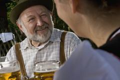 Two people in a beer garden - stock photo