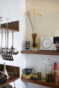 Detail of household items on kitchen shelves Stock Photos