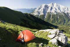 A tent on the slope of the Wetterstein mountain range - stock photo