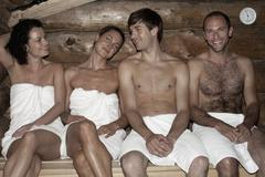Four friends in a sauna - stock photo