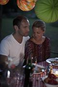 A couple at a dinner party, outdoors, night Stock Photos