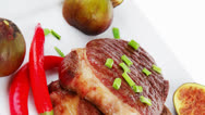 Stock Video Footage of grilled beefsteak served with hot cayenne peppers