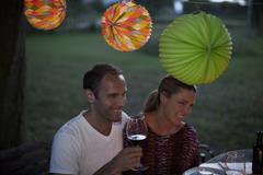 A couple at a dinner party, outdoors Stock Photos