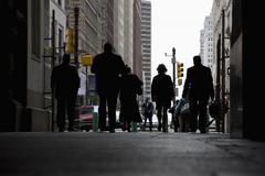Rear view of pedestrians in an arcade, Philadelphia, PA, USA Stock Photos