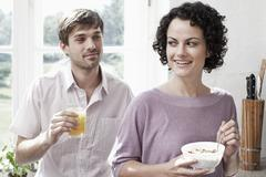 A couple having breakfast in the kitchen Stock Photos