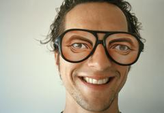 A man wearing novelty glasses and smiling Stock Photos