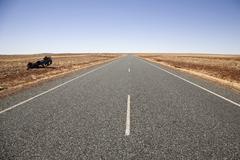 Highway through a barren landscape, Port Hedland, Australia Stock Photos