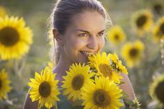 A woman in a sunflower field, portrait Stock Photos
