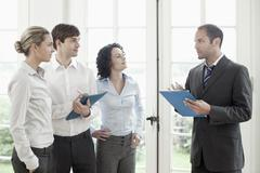 Business colleagues talking - stock photo