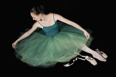 A ballet dancer adjust her tutu Stock Photos