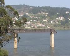 Wide shot - collapsed Hintze Ribeiro Bridge, river Douro Stock Footage