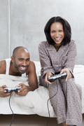 A young couple playing a video game - stock photo