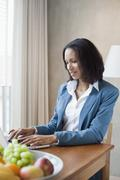 A businesswoman working at a desk Stock Photos