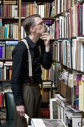 A man scrutinizing books in a bookstore Stock Photos