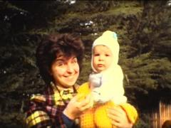 Super 8 baby with mother Stock Footage