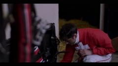 JOCKEY BEFORE HORSE RACE Stock Footage
