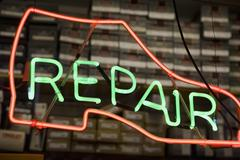 Neon shoe repair sign Stock Photos