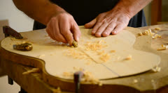 Luthier hands making a guitar Stock Footage