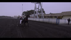 HARNESS RACING - HORSE AND JOCKEY PASS BY Stock Footage