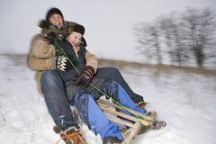 A mother and her son sledding Stock Photos
