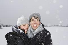 A heterosexual couple embracing, outdoors, portrait Stock Photos