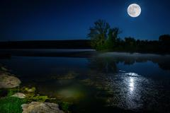 moon over lake - stock photo