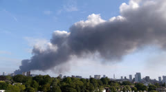 Smoke plume from a large city fire. Timelapse. Stock Footage